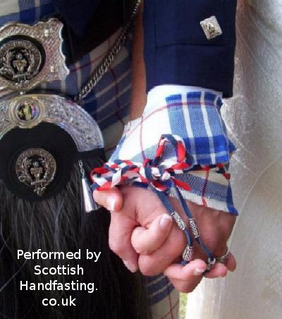 Handfasting at a wedding. Copyright.
