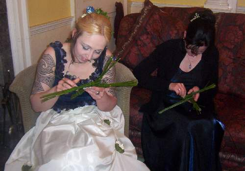 Bride and Maid making Cross as part of reception Entertainment