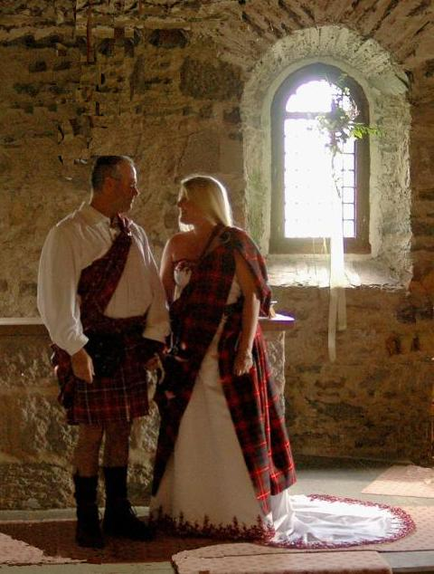 Handfasting, decked in plaids. Copyright.